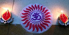 Rangoli with Om Chakra and Diya