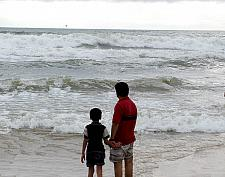 Father child looking waves at Calangute Beach